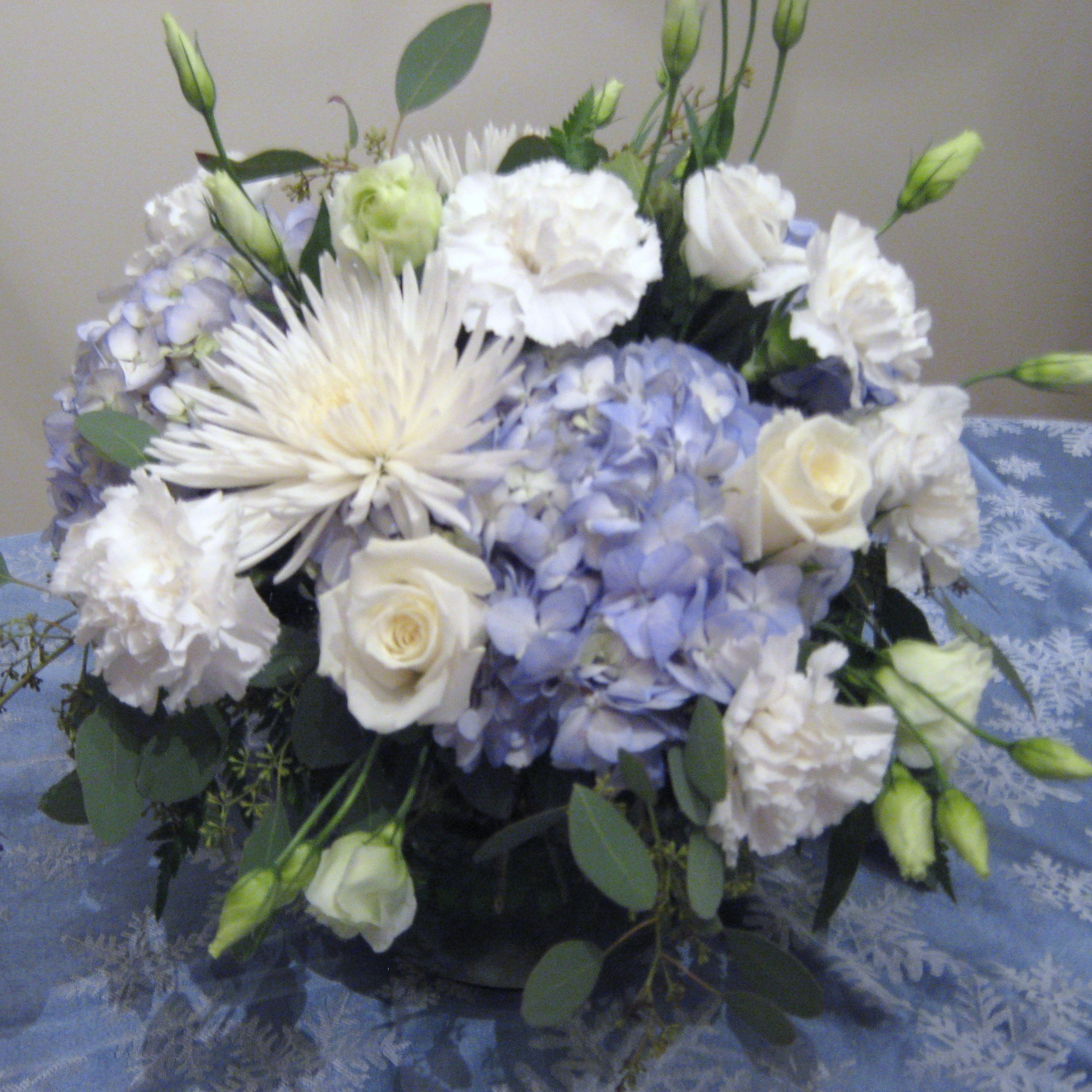 Blue white flowers for a winter buffalo wedding