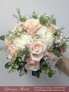 almond and blush pink bridesmaid bouquet flowers and dress