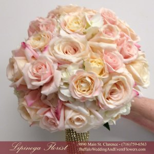 Lipinoga Florist of Clarence NY designed pink and gold Bridal Bouquet for Real Buffalo Wedding